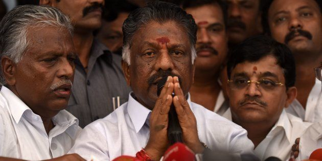 O Panneerselvam (C) during a press conference at his home in Chennai on February 14,