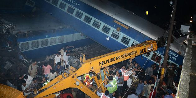 Emergency workers look for survivors on the wreckage of a train carriage after an express train derailed...