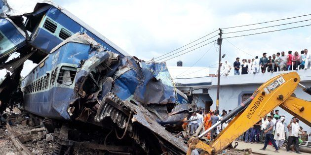 Coaches of the Kalinga Utkal Express train after it derailed in