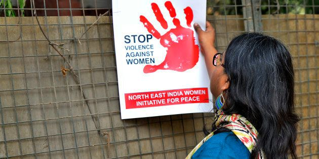 FILE PHOTO: A woman protests against the brutal assault and rape of 24 year old girl in Hauz Khas village...