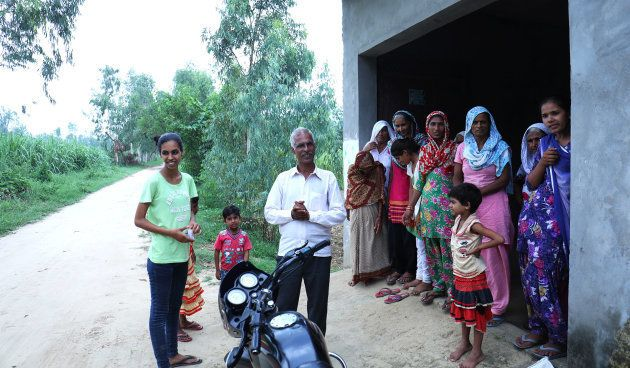 Manvi with her family in their home in Dhanauri Mafi village in Uttar