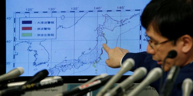 Japan Meteorological Agency's earthquake and volcano observations division director Koji Nakamura points...