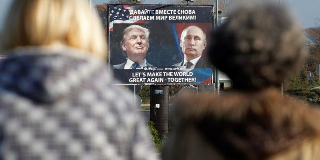 A billboard showing pictures of US president-elect Donald Trump and Russian President Vladimir Putin...