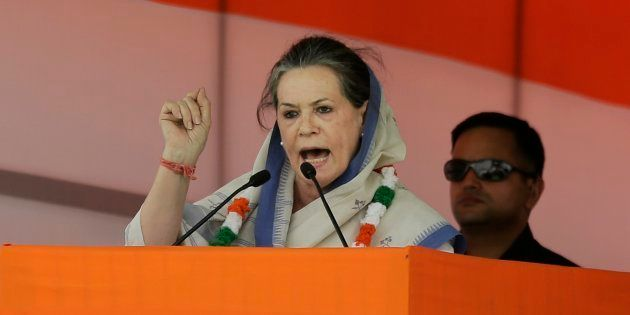 India's opposition Congress president Sonia Gandhi addresses a farmers rally in New Delhi, India, Sunday,...