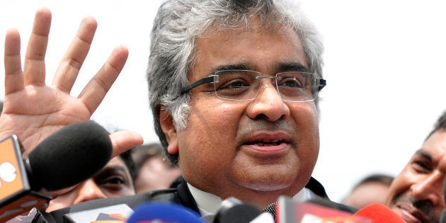 Harish Salve, council for Reliance Industries Ltd., speaks to reporters after a hearing at the Supreme...