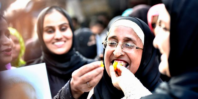 Muslim women celebrate after verdict given by the Supreme Court for banning Triple