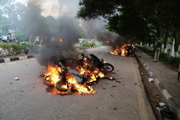 PANCHKULA, INDIA - AUGUST 25: Burning vehicles are seen after Dera followers fire up the vehicles in...