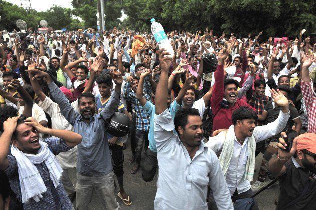 PANCHKULA, INDIA - AUGUST 25: Dera Followers Celebrating when they got fake news about releasing of Dera...