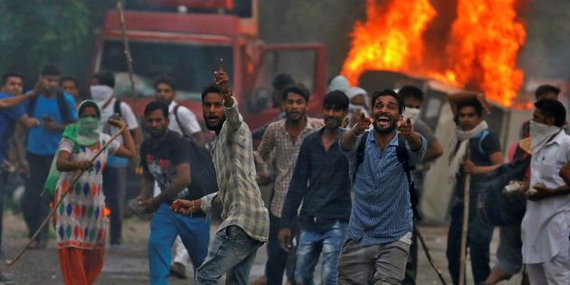 People react during violence in Panchkula, India, August 25, 2017. REUTERS/Cathal McNaughton TPX IMAGES...