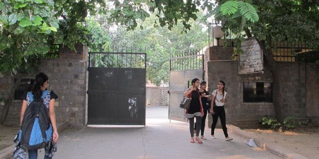 Students in at the gate of the women's dorm of Miranda House, a women's college in Delhi University....
