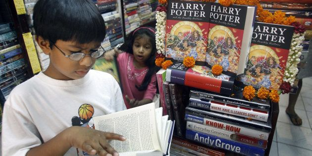 A young reader reads leafs through a copy of Harry Potter and the Deathly Hallows at a bookshop in New