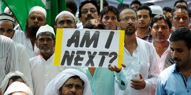 JULY 18: Protesters hold placards as they take part in a sit-in over a spate of assaults against Muslims...