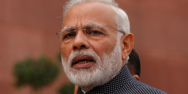 India's Prime Minister Narendra Modi speaks to the media inside the parliament premises on the first...