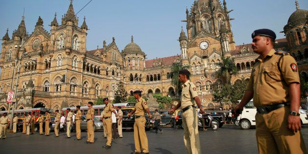 Indian policemen stand guard outside the Chhatrapati Shivaji train station, one of the sites of the 2008...