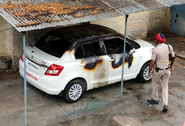 A torched car inside the office of income tax office in Mansa that was set affire by protesting Dera...
