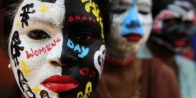 TOPSHOT - Indian students pose with their faces painted at a college in Chennai on March 7, 2017, ahead...