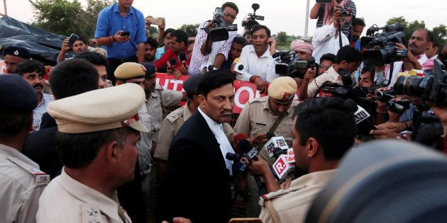 S. K. Garg Narwana, lawyer of Gurmeet Ram Rahim Singh, a self-styled godman, speaks with the media after...