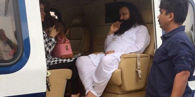 Panchkula: Dera Sacha Sauda chief Gurmeet Ram Rahim in a helicopter in which he was flown from Panchkula...