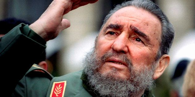 Cuba's President Fidel Castro gestures during a tour of Paris in this March 15, 1995 file