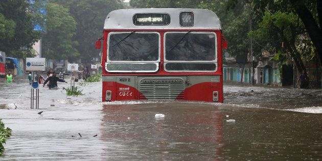 A passenger bus moves through a water-logged road during rains in Mumbai, India, August 29, 2017. REUTERS/Shailesh