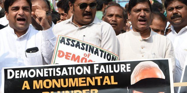 Indian Congress Party supporters shout slogans during a protest against demonetisation at the Reserve...