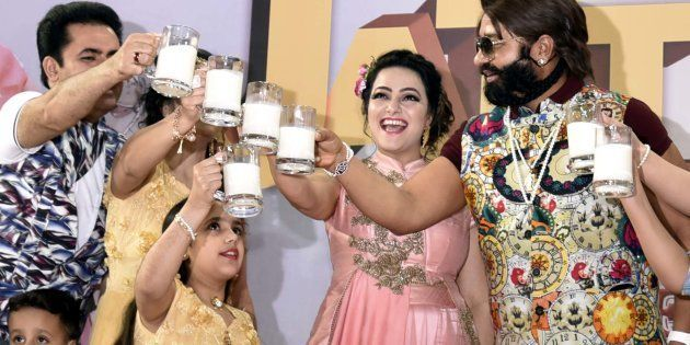 Rape convict Ram Rahim ji Insaan with Honey Preet Insaan during a Cow Milk Party to appeal to Prime Minister...