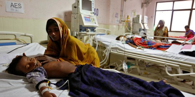 Children are seen in the Intensive care unit in the Baba Raghav Das hospital in Gorakhpur district, India...