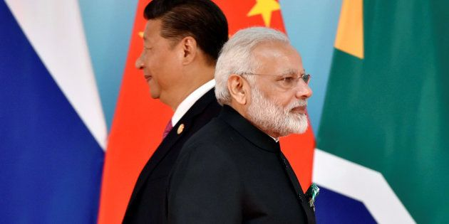 Chinese President Xi Jinping (L) and Indian Prime Minister Narendra Modi attend the group photo session...