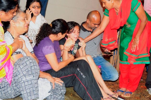 Family members and relatives of 55-year-old Gauri Lankesh, who was shot dead by unknown assailants in...