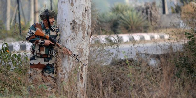 An Indian army soldier stands guard during a gun battle with armed militants at an Indian army base at...