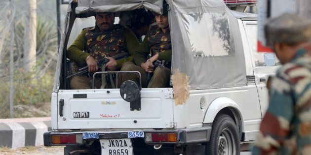 Indian army soldiers take position during a gun battle with armed militants at an Indian army base at...