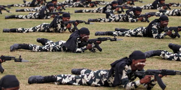 India's Central Reserve Police Force (CRPF) personnel take part in the passing out parade in Humhama,...