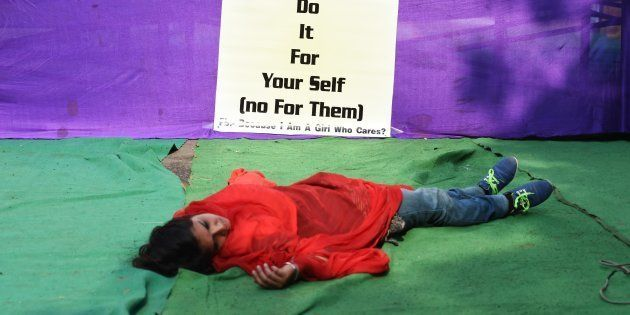 An Indian activist participates in a street play to create awareness on violence against women in New...