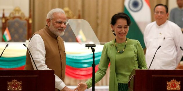 India's Prime Minister Narendra Modi and Myanmar's State Counselor Aung San Suu Kyi talk to reporters...
