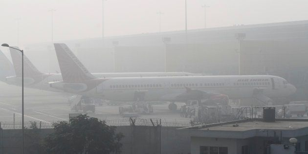 Flights Delayed And Cancelled As Dense Fog Engulfs