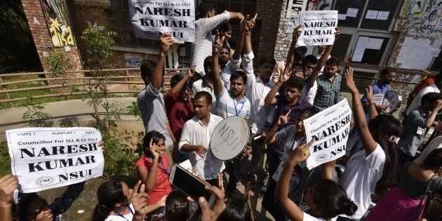 NSUI supporters shout slogans during JNU Student Union election Voting Day at the