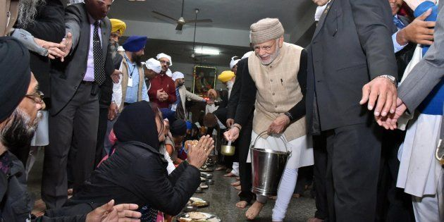 Amritsar: Prime Minister Narendra Modi serves langar during his visit at Golden temple on the eve of...