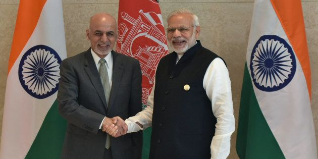 Indian Prime Minister Narendra Modi (R) shakes hands with Afghan President Ashraf Ghani (L) during the...