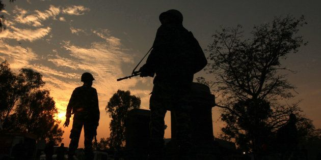 Soldiers patrol on the Jammu-Srinigar National Highway during a combing operation after Nagrota
