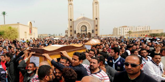 Relatives mourn the victims of the Palm Sunday bombings during the funeral at the Monastery of Saint