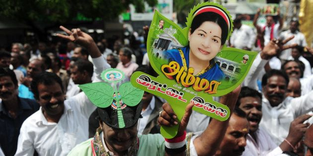 Members of AIADMK party carry placards with the image of Jayalalithaa. ARUN SANKAR/AFP/Getty