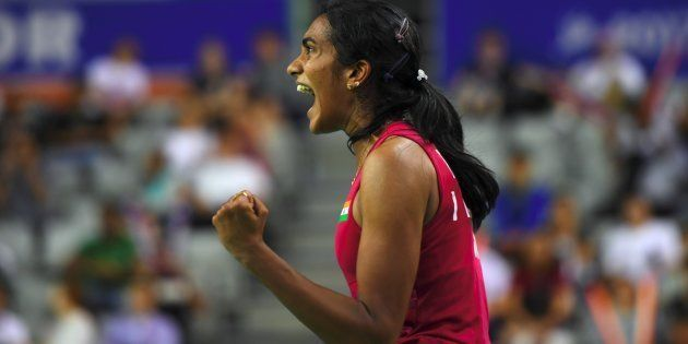 India's Pusarla V. Sindhu reacts to a point against Japan's Nozomi Okuhara during the women's singles...