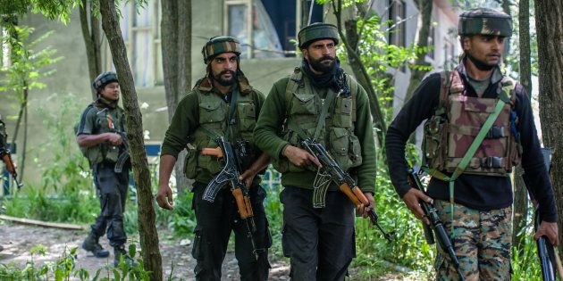SAIMOH, KASHMIR, INDIA - MAY 27: Indian army troopers guard the area where top rebel commander of Hizbul...