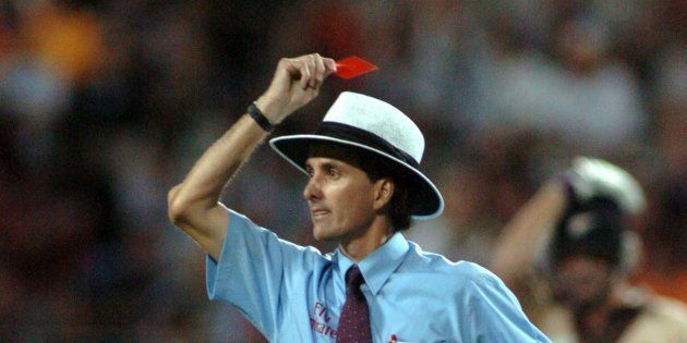 AUCKLAND, NEW ZEALAND - FEBRUARY 17: Umpire Billy Bowden shows Australian bowler Glen McGrath (not in...