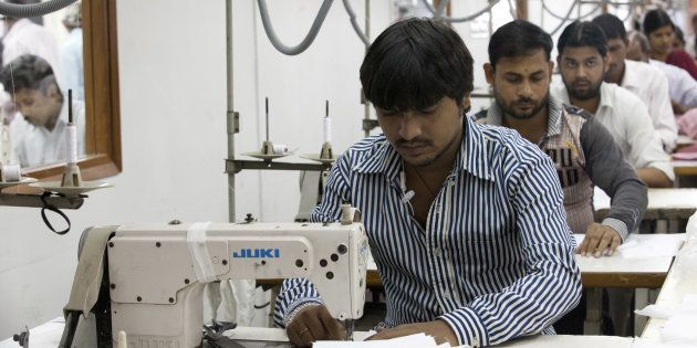 Labourers sew linens at the April Cornell clothing factory in