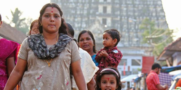 Indian women with children walking at the famous temple Sri