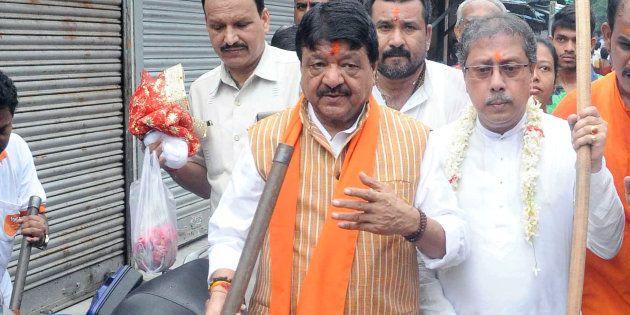 Bharatiya Janta Party General Secretary Kailash Vijayvargiya (left) at the cleanness drive at Kalighat...