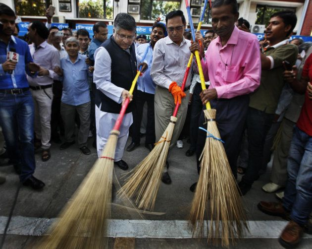Union Telecom, IT and Law Minister Ravi Shankar Prasad wields broom as he launched cleanliness drive...