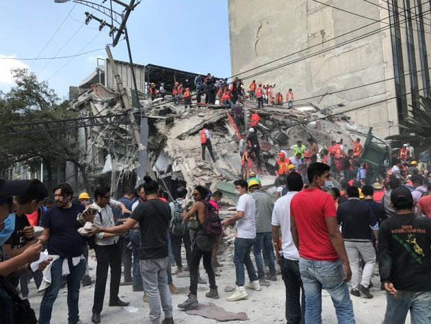 People work at the site of a collapsed building after an earthquake hit in Mexico