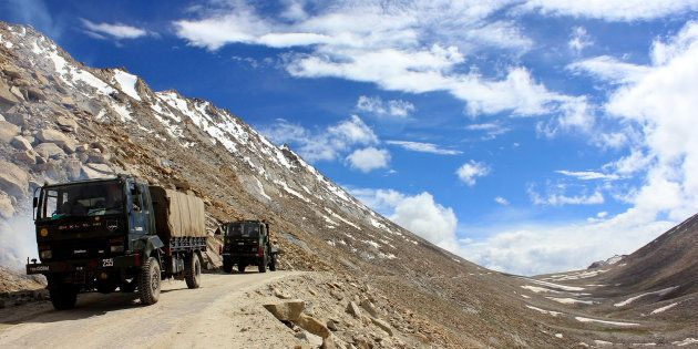An Indian army convoy moves towards the border in Pangong, a disputed territory between India and China,...